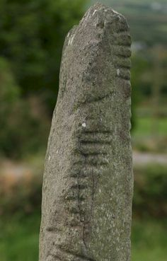 Ogham (pronounced 'oh-am') is a primitive alphabet, sometimes called the Celtic Tree Alphabet, which takes the form of linear strokes cut into stone or etched onto wood. It is found extensively in Ireland but also in Scotland, Wales, England and the Isle of Man.  The characters of the Ogham alphabet each comprise between one and five perpendicular or angled strokes arranged around a central line.