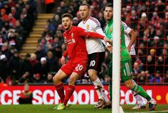Adam Lallana in action with Wayne Rooney and David de Gea