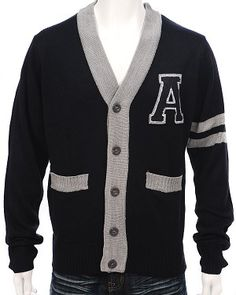 Letterman knitted cardigan...Bocle letter patch, contrasting trim...Available in Black,Charcoal,Navy, Orange, Red or White: