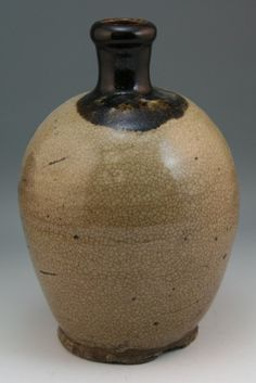 """Antique Chinese Tang-Style brown crackle glazed ceramic wine bottle (usual aged wear and minor cracks on body), probably Tang Dynasty; Size: H: 9-1/2"""""""