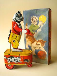 Cat bounces Ball on erratically moving wheeled platform...Germany, 1950s
