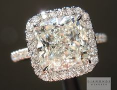 Halo cushion cut diamond ring with diamond band. absolutely looooooooooove this..!