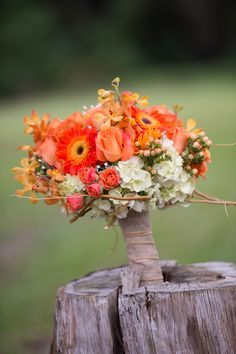 Idea of how to display bridesmaids bouquets at dance in front of wedding party table