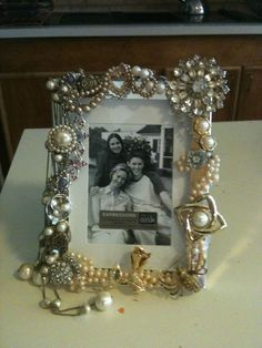 Used my grandmothers old jewelry to cover this picture frame.