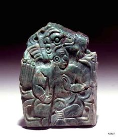 Maya. jade plaque. Seated ruler wearing animal headdress.