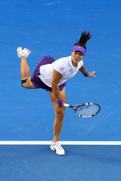 Na Li of China serves in her women's final match against Victoria Azarenka of Belarus during day thirteen of the 2013 Australian Open at Melbourne Park on January 26, 2013 in Melbourne, Australia.