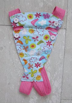 Baby doll carrier, I like the crossed straps and simple design on this one. I should be able to do it in two hours.