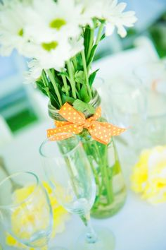 Country wedding, reception, citrus, pompoms, daisies, ribbon, table setting