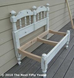 Buy two 2x4's to connect the headboard & footboard.  Using a jig saw cut a curve in 3 boards for a seat. Cut four 1x3's in half to make the slats for the seat.  Should do this with moms old twin bed.