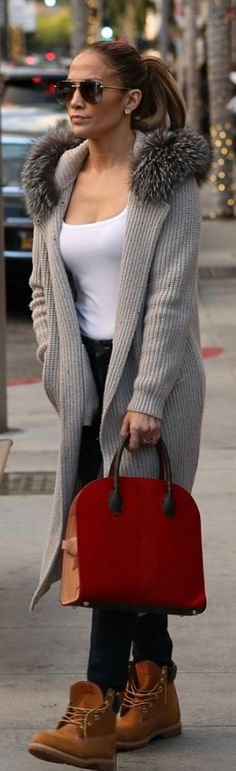 Who made Jennifer Lopez's aviator sunglasses, red handbag, tan ankle boots, and cardigan ribbed tan sweater?