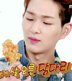 Onew (SHINee).  I'm sorry; is he eating that chicken or making out with it?  (.gif set).