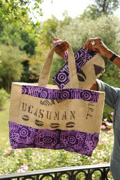 Combining hand‐dyed African textiles with up-cycled burlap sacks, the Middle Passage Line pulls inspiration from our African and southern agricultural, political and cultural heritage, exemplifying the hottest in eco-ethnic fashion. The product pays tribute to the memory and endurance of our ancestors who made the journey and to those who were left behind.    The Middle Passage Large Tote (17x14) is fully lined with African fabric and a zipper pocket in the bag's interior. — Southern…
