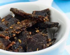 recipe for Biltong: 2 kg  beef fillet   • 150 ml  red wine vinegar   • 50 ml  Worcestershire sauce   •  handful coriander seeds, coarsely ground   • 1 tbsp  black pepper, coarsely ground   • 500 g fine sea salt   • 150 g  brown sugar   • 1 tsp  bicarbonate of soda  click on the link for the method. Can use food dehydrator instead of hanging the meat