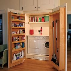 I love the way the brooms are stored in the door. This would be awesome for a pantry/kitchen closet.