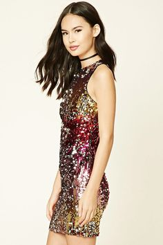 A knit bodycon dress featuring a multicolored sequin design, a round neckline, sleeveless cut, and a concealed back zipper.