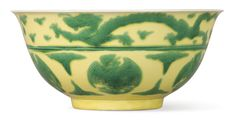 RARE YELLOW-GROUND GREEN-ENAMELLED 'DRAGON AND PHOENIX' BOWL, MARK AND PERIOD OF KANGXI