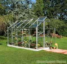 Minimal, beautiful greenhouse with lush, green lawn. Halls Popular 6x10 Greenhouse. Greenhouses & pavilions by Greenhouse Stores