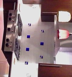 Glass mosaic accent tile in cobalt blue dichroic glass inset into white subway tile kitchen backsplash.  Uneek Glass Fusions. www.uneekglassfusions.com Subway Tile Kitchen, Kitchen Backsplash, Dichroic Glass, Mosaic Glass, Cobalt Blue, Kitchen Countertops, Cobalt