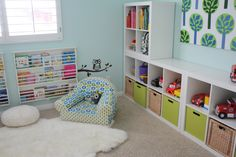 Love this play room. The storage and the paint color- it's a Valspar brand.