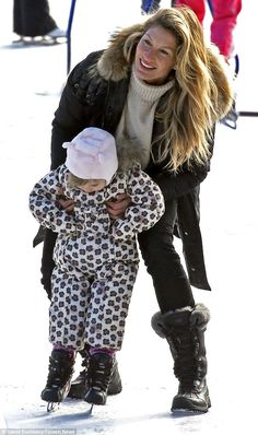 On solid ground: While she aided her daughter through her skating session, Gisele opted no...