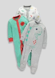Boys three pack sleepsuit. One grey marl sleepsuit with fun dino design to front with 3D green spikes to opening. One green and white sleepsuit with boucle...