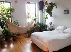 Small bedroom, hammock, plants, white, wood