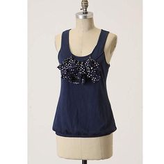 "Anthropologie Little Yellow Button Navy Tank Anthropologie by little yellow button. Jersey tank featuring a scoop neck with dangling polka dot ruffles. 100% Cotton. Last photo is my own. Length of this top measures approximately 25"" ⚡️no trades & no paypal⚡️ Anthropologie Tops Tank Tops"