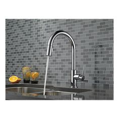 Bring delicate beauty to your kitchen sink with this Delta Trinsic Single-Handle Pull-Down Sprayer Kitchen Faucet with MagnaTite Docking in Chrome. Kitchen Faucets Pull Down, Kitchen Faucet Reviews, Best Kitchen Faucets, Kitchen Pulls, Kitchen Handles, Delta Trinsic, Delta Faucets, Black Kitchens, Updated Kitchen