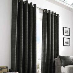 Equipped with an eyelet header, these fully lined curtains are finished in black…
