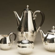 "Gallery 925 -     ""Cosmos"" coffee and tea service in the large size designed by Johan Rohde in 1915 for Georg Jensen. This set is in superb condition with all original details intact. Ebony handles. Coffee pot in 11"" H, Tea 6.5"" H, Creamer and sugar 4.25""H.   A similar example can be seen in the book GEORG JENSEN HOLLOWARE, The Silver Fund Collection by David Taylor and Jason Laskey, pg. 68."