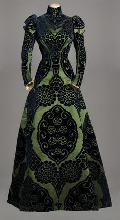 Tea gown, Worth, 1895. Blue cut velvet on a green satin ground, green silk taffeta lining.