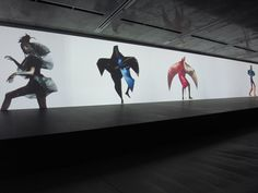 irving penn's photographs of issey miyake's designs being projected onto the screen  image © designboom