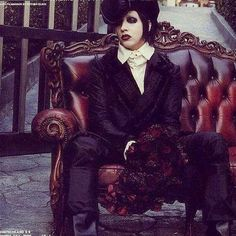 Marilyn Manson... Looks like he's about to go to prom or something... I'd totally go with him. XD