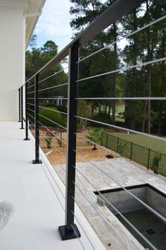 Flat top cable railing system, top mounted with base plate covers and powder coated black