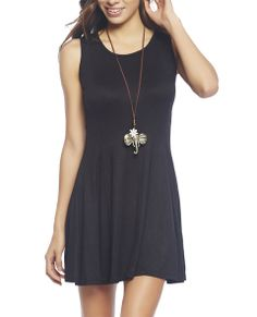 """Obsessing over this must have tank dress, it's so easy to accessorize, and take from day to night in no time! It features a solid knit body with a scoop neck, multiple seams creating a flounce bottom, and a relaxed fit.  Model is 5'9"""" and wears a size small   95% Rayon / 5% Spandex Machine Wash USA"""