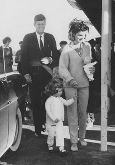 John F. Kennedy with wife Jackie and daughter Caroline, 1960.