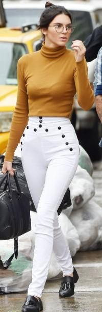need this mustard turtle neck top with white skinny denims as Kendall Jenner is wearing