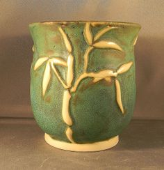 hand sculpted pottery | Hand carved ceramic vase, with bamboo and leafs.
