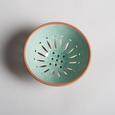 Oh, so charming handmade stoneware berry bowls for rinsing and serving in style. Can also be used as a colander for pasta. Available in four distinct colors. #handmade