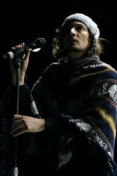 Leon Larregui...he is my favorite artist<3 I love the way he sings<3 I want a poncho so bad.<3 he has one, i want one too, hehehe^^