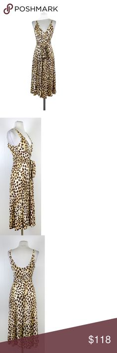 "L.A.M.B.- Tan & Cream  Leopard Print Jersey Dress Sz 4 Comfortable jersey dress in fun leopard print. V-neck & wrap-style top add touches of femininity. Size 4 100% viscose Sleeveless Top closes w/back tie Empire & drop waist seams Shoulder to hem 45"" L.A.M.B.(Love. Angel. Music. Baby) - a flirty rocker label representingGwen Stefani'sstyle, music and personality. If you love everything that you've seen Gwen Stefani rock, then surely you will find something to love within her own designer…"