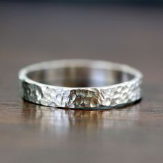 Sterling silver hammered wedding ring or everyday ring. Tiny ball like hammered pattern covers this silver ring that reminds me of the moon's surface. The ring measures about 3.5 mm wide. This ring is