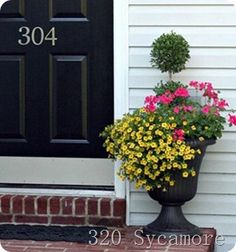 I love the little yellow flowers! they are calibrachoa (or million bells). The pink are geraniums. Color combo is nice!