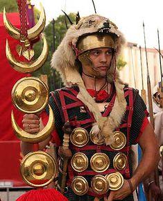 Roman legionary. Crescent is a Moon/Luna symbol and golden disks are the Sun.