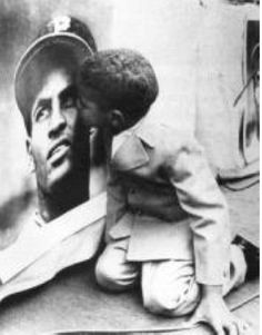 Roberto Clemente, Jr., kissing his father's picture (via)  On This Day in Pittsburgh History: August 17, 1965 Baseball broadcaster and former pro Roberto Clemente, Jr. is born in San Juan, Puerto Rico. He is the oldest of three sons fathered by Pittsburgh Pirates legend Roberto Clemente, the first Latin American player to record 3,000 hits and enter the Major League Baseball Hall of Fame. (via)