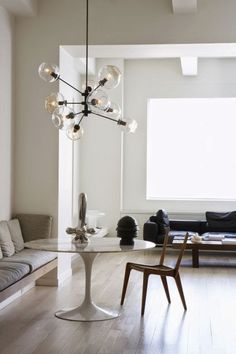 Have Knoll table for kitchen (diameter 140, white cararra marble top).  Also like the window seat arrangement.