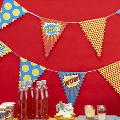 A string of vibrant, loud and colourful Pop Art themed bunting with a different design on alternate flags, some with the word POP, POW or Wow on them. This bunting will jazz up any party venue. Great for lots of special occasions from an adults 30th birthday party to a kids superhero themed party. The bunting is made of card and is 3.5 metres long with 14 flags which are 22.5cm long and 15.5 cm wide at the top.