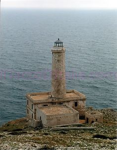 Capo d'Otranto Lighthouse sits at on the shores of the Adriatic Sea Italy