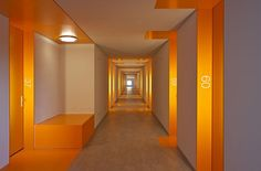 Student Dormitories by HVDN Architecten. When a door's detail makes all the difference in a otherwise boring corridor design. Brilliant choice of the orange color.