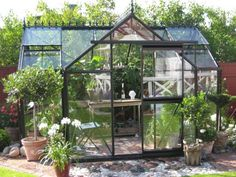 Junior Victorian Greenhouse will be a great addition to your yard or garden area. This tempered glass greenhouse from Belgium features sidewalls, two roof windows, sliding door, large bottom frame, gutters and downspouts. Stoke Park, Victorian Greenhouses, Greenhouse Plans, Greenhouse Wedding, Greenhouse Gardening, Gardening Tools, Shed Kits, Roof Window, Potting Sheds